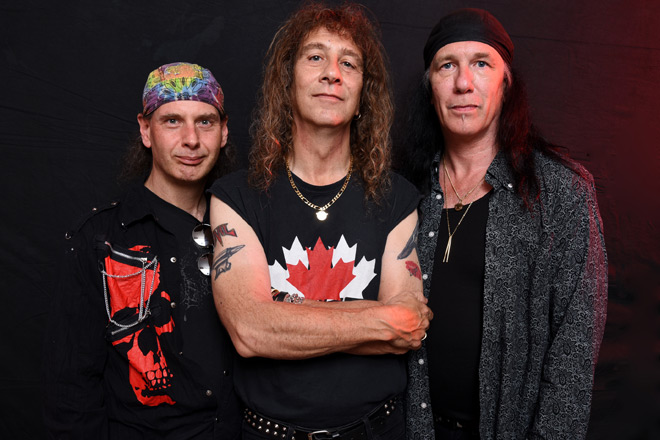 Anvil promo - Anvil - Pounding the Pavement (Album Review)